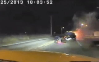 Heroic police officer drags unconscious man from burning car