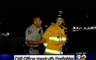 Police officer arrests fire fighter at crash scene