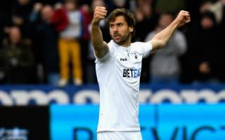 Swansea City 3 Burnley 2: Llorente's injury-time header secures crucial win