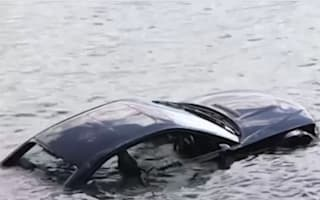 Video: Woman rescued from sinking car by rock-wielding police