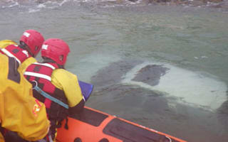 Pensioner rescued after 'deliberately' driving into sea