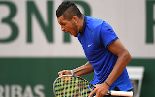 Kyrgios through after umpire verbals on damp day in Paris