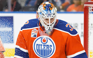Streaking Oilers sink Canucks, Flames roll on