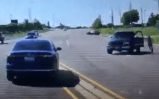 Watch the incredible moment a motorist leaps into a moving car after the driver has a seizure.