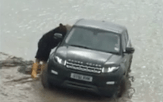 Range Rover is nearly washed out to sea