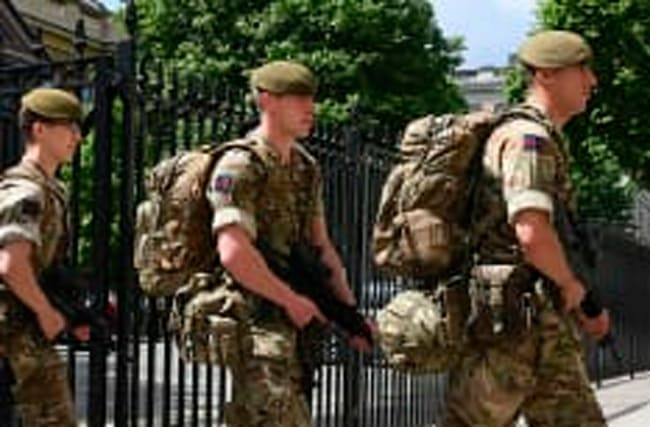 Armed soldiers hit UK streets in wake of Manchester attack
