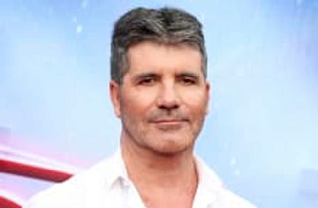Which X Factor 2016 act has signed a deal with Cowell?