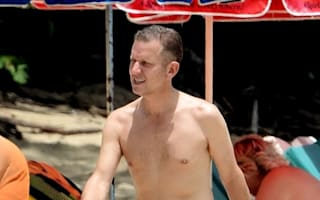 Jeremy Kyle does pink shorts on Barbados beach