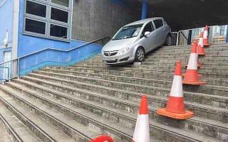 Corsa caught on concrete steps after sat nav mishap