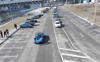 Daredevil flips over speeding BMW i8 sports car