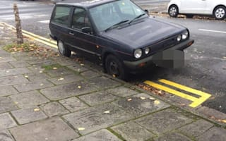 Contractors moved car to paint double yellow lines then dragged it back onto them and ticketed driver