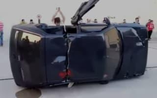 Video: Spanish men hack Peugeot 205s in half with axes