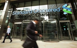 £416m charge for Standard Chartered