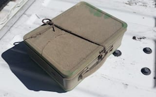 Man remodelling house finds suitcase full of cash