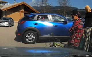 Young boy stops driver parking so mother can use space
