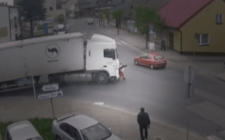 Watch the moment a woman was run over by a truck and walked away