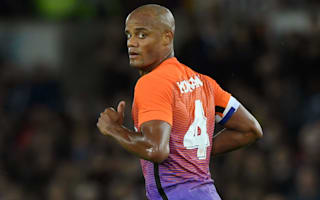 Swansea City 1 Manchester City 2: Kompany limps off as holders ease through