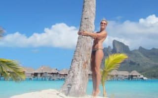 Heidi Klum poses topless on holiday in Bora Bora