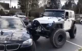 Road rage Jeep driver shunts badly-parked BMW between white lines