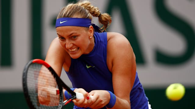 Kvitova wins opening match on grass in Birmingham