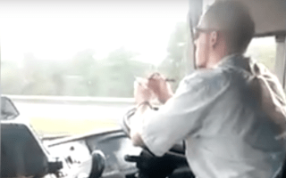 Megabus driver filmed steering with his elbows