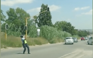 Dancing traffic warden dazzles drivers