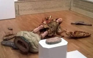 Eek! Tourist knocks over museum statue while taking selfie