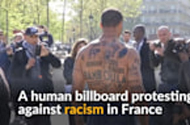 Covered in insults, human billboard protests against racism in France