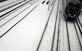 Swedish male train drivers don skirts in uniform row
