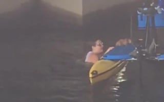 Woman jumps off paddleboat to save cat