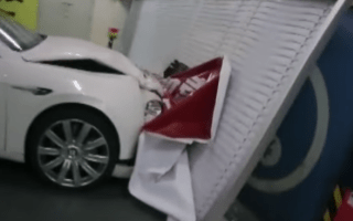Watch a Bentley Flying Spur roll out of control into a wall