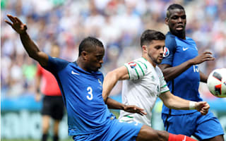 Reluctant father figure Evra defends Pogba