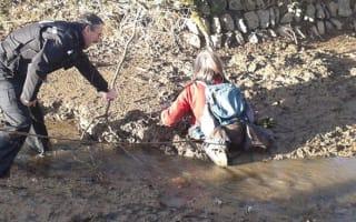 Dramatic rescue as walker gets stuck waist-deep in mud on Dartmoor