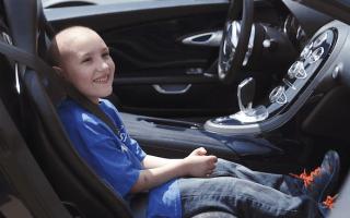 Dream Bugatti ride becomes reality for severely ill child