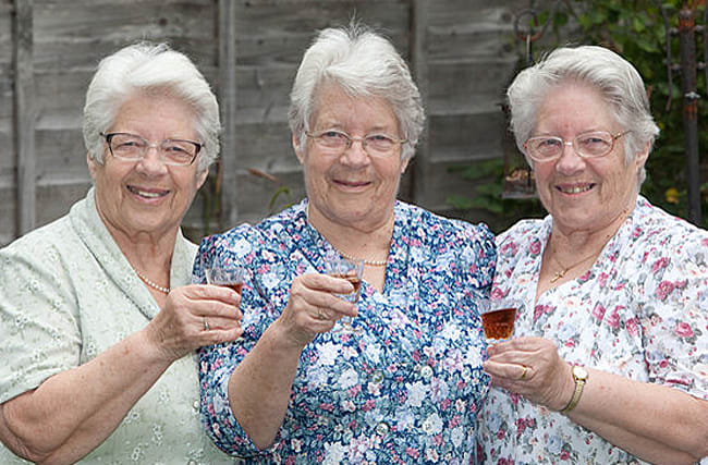 Britain's oldest triplets celebrate their 80th birthday