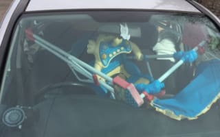 Motorist caught driving with high chair around her head