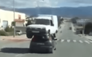 Video captures driver carrying van on the roof of his car
