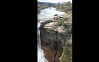 Watch this daredevil plunge off a rock into 40ft waterfall