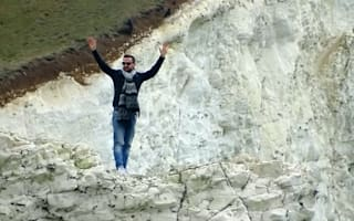 Couple risk lives playing 'chicken' on 200ft crumbling cliff edge