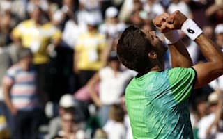 Vesely stuns Djokovic, but ominous Nadal powers through