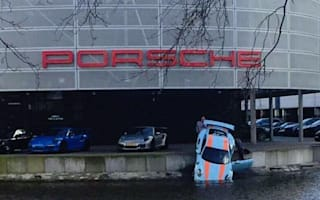 Porsche 911 rolls into lake outside dealership in Holland