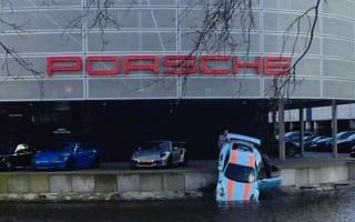 Porsche 911 rolls into lake outside dealership in Holland