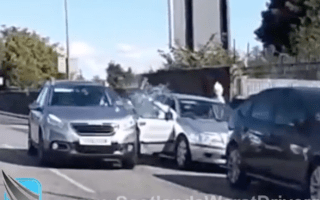 Watch a driver smash into the opened door of a parked car