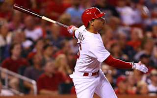 Cardinals end seven-game skid as Rockies stay hot