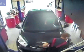 Mechanic run over after driver accelerates off garage ramp