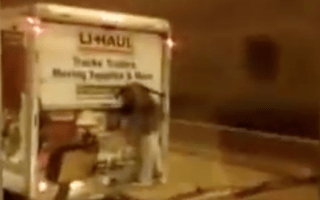 Thief left clinging to delivery van after attempted break-in goes wrong
