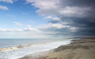 Man dies after cliff collapse on beach in Suffolk