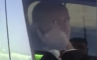 Police officer caught on camera using mobile at the wheel