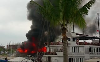 Tourists jump from Vietnamese cruise ship as it bursts into flames