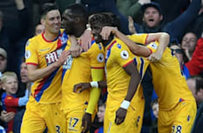 Benteke double at Anfield steers Palace toward safety